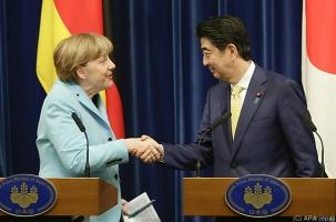 Меркель продвигает антироссийские санкции в Токио